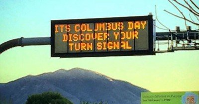 It's Columbus day discover your turn signal  – sign
