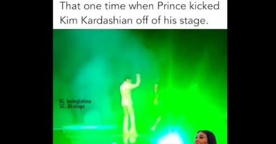 Prince kicks Kim Kardashian off stage – video